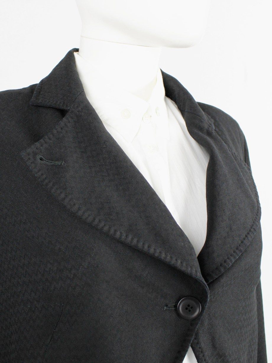 Ann Demeulemeester black cutaway blazer with cropped sleeves — fall 1993