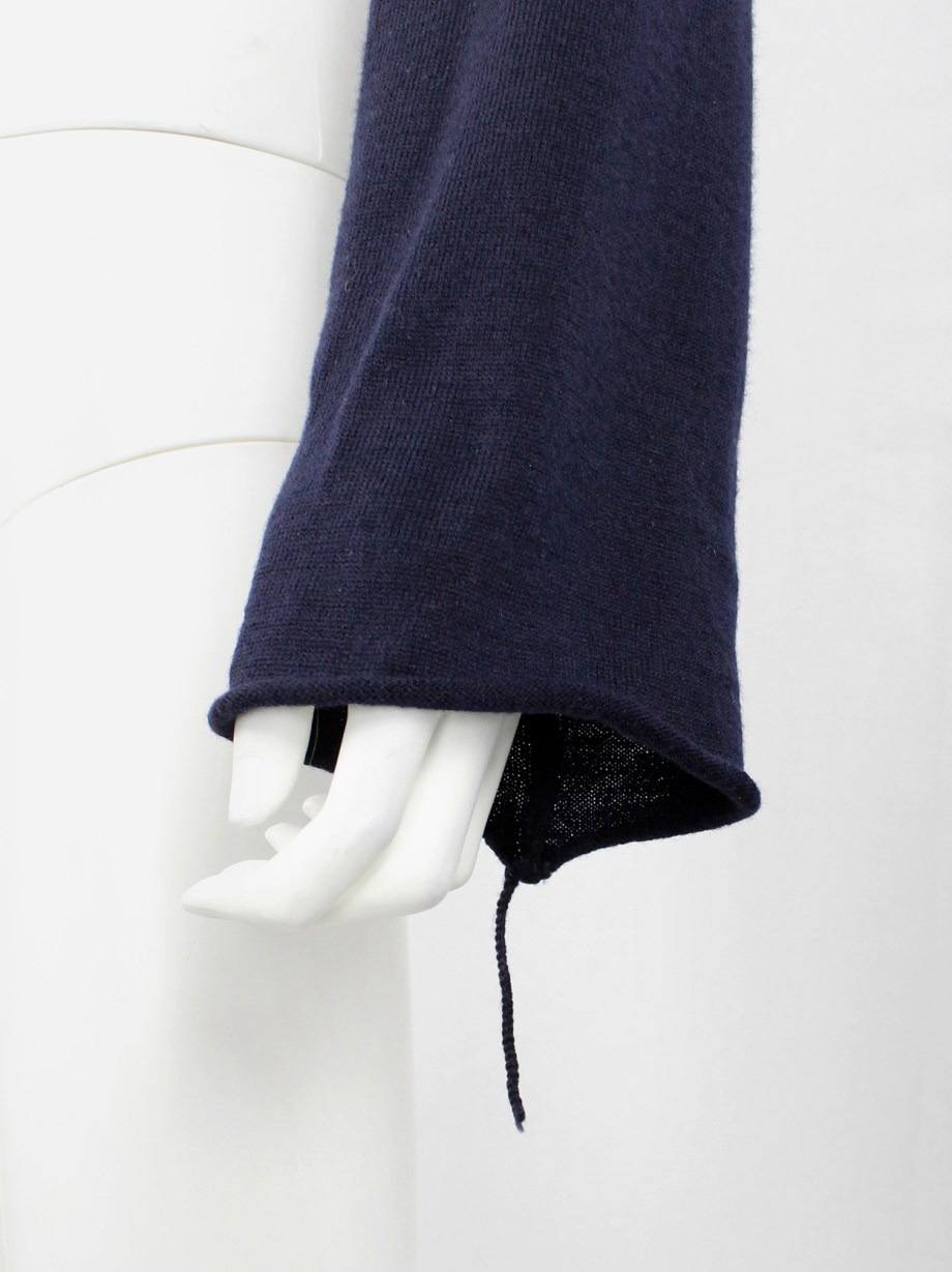 Maison Martin Margiela blue bolero with cuffed sleeve and sleeve with loose thread — fall 2004