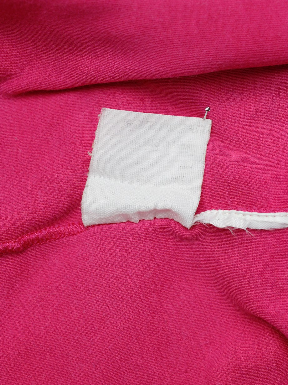 Maison Martin Margiela reproduction of a 1993 pink top with shoulder snap buttons — spring 1999