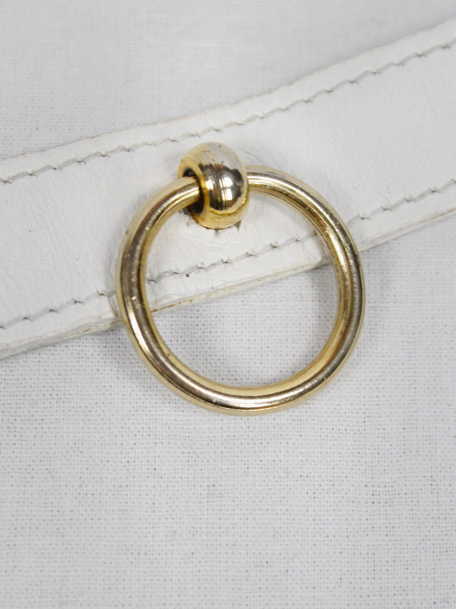 Xavier Delcour white leather bracelet with gold bondage ring