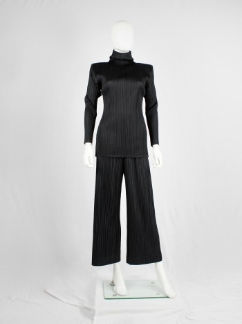 Issey Miyake Pleats Please black pleated trousers with wide legs and fake button closure