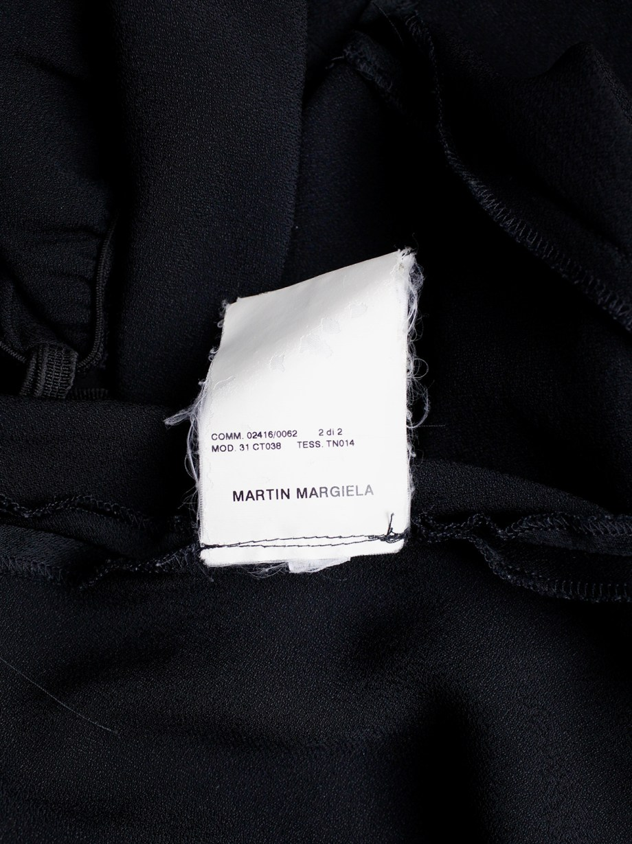 Maison Martin Margiela black backless dress with straps modeled after a car seat cover — fall 2006