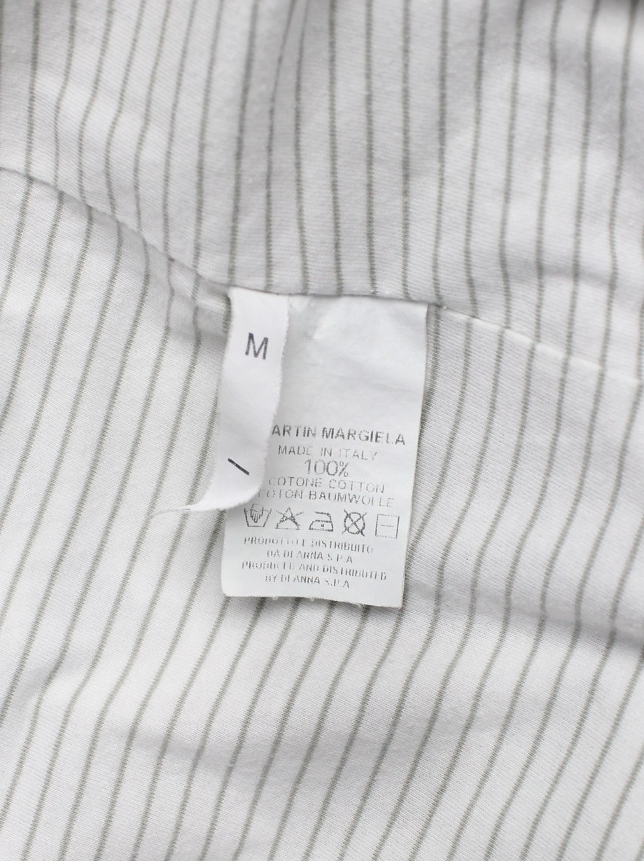 Maison Martin Margiela white inside out t-shirt hanging on the front of the body — spring 2003