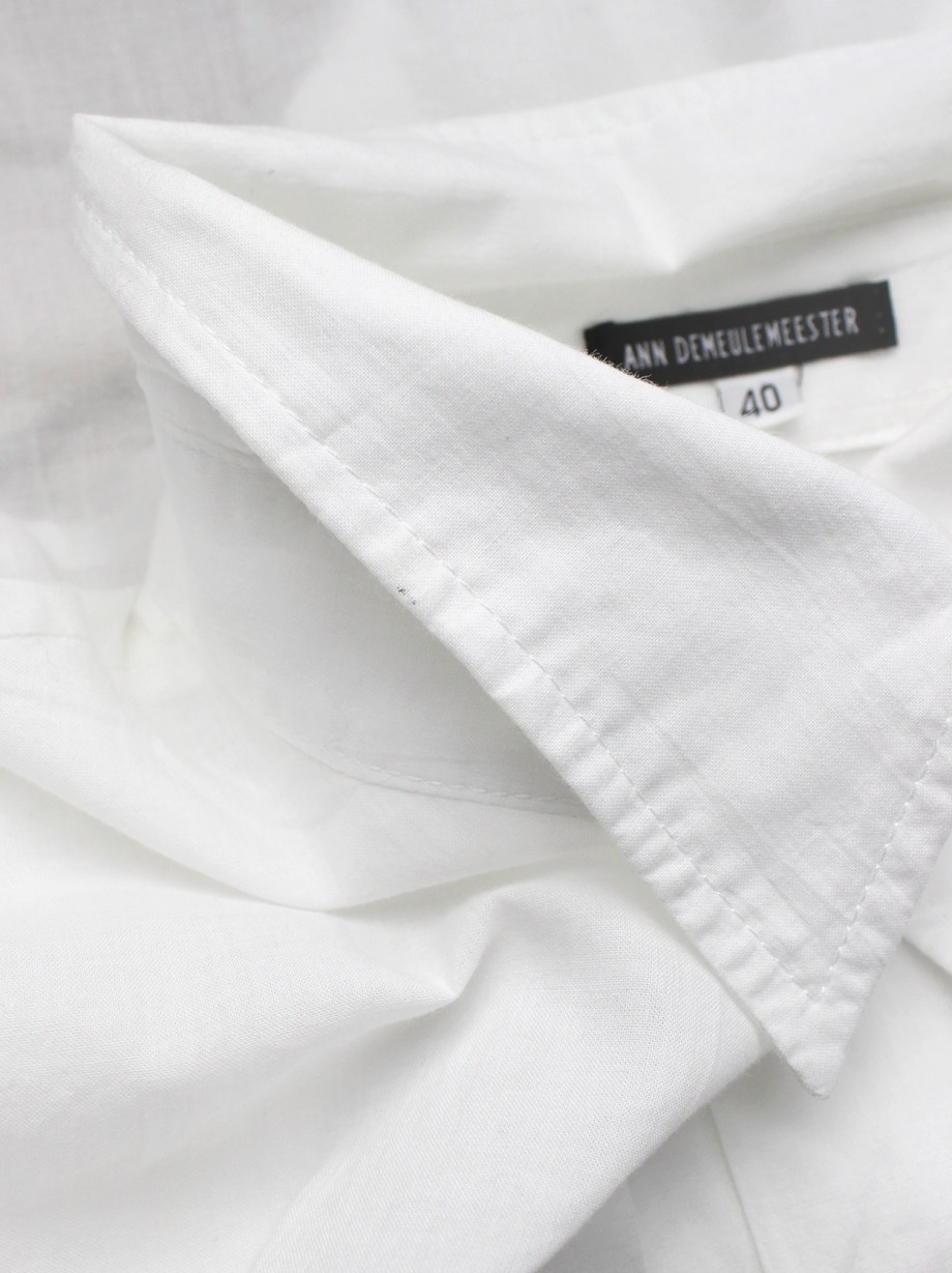 Ann Demeulemeester white cropped shirt with extra long sleeves and semi-covered buttons
