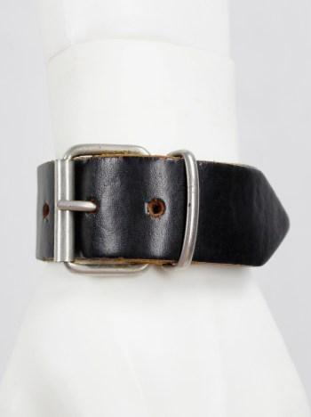 Lieve Van Gorp black leather belt bracelet with embossed logo
