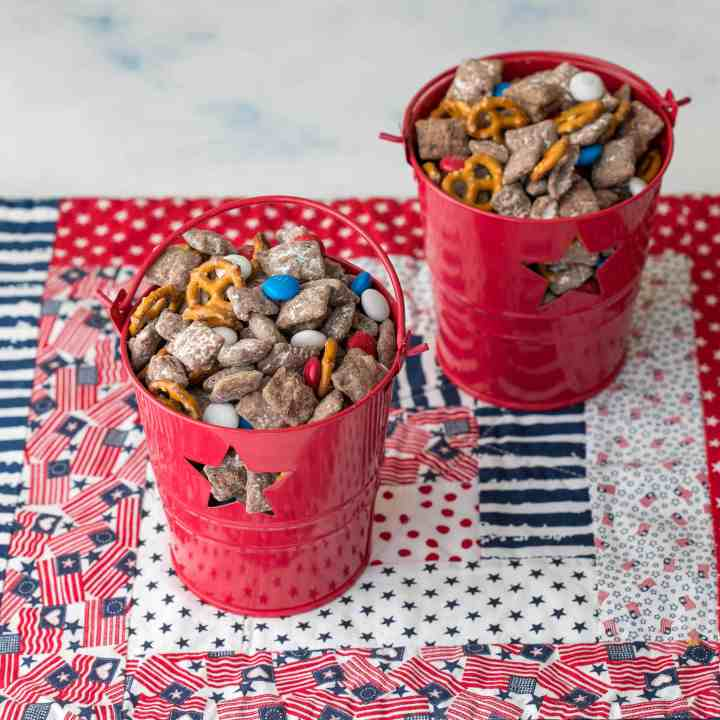 two containers 4th of July puppy chow with patriotic placemat