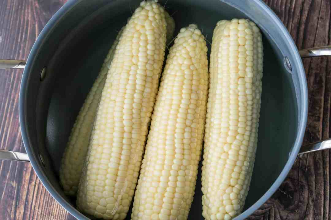 large pot of boiled corn on the cob
