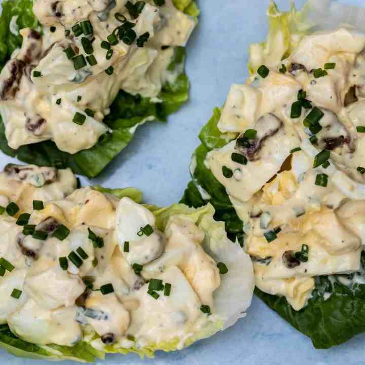 close up of egg salad on lettuce cups