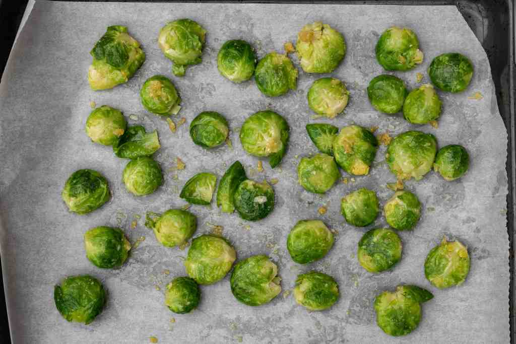 smashed brussels sprouts on sheet pan before baking
