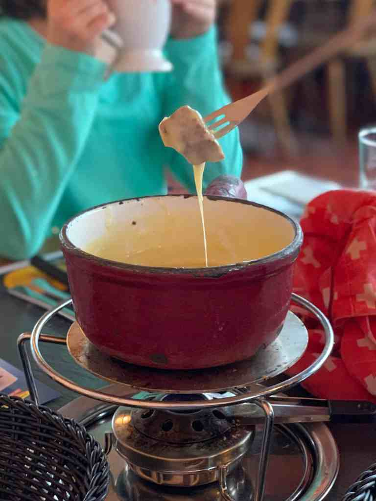 cheese fondue at restaurant on the top of harder kulm