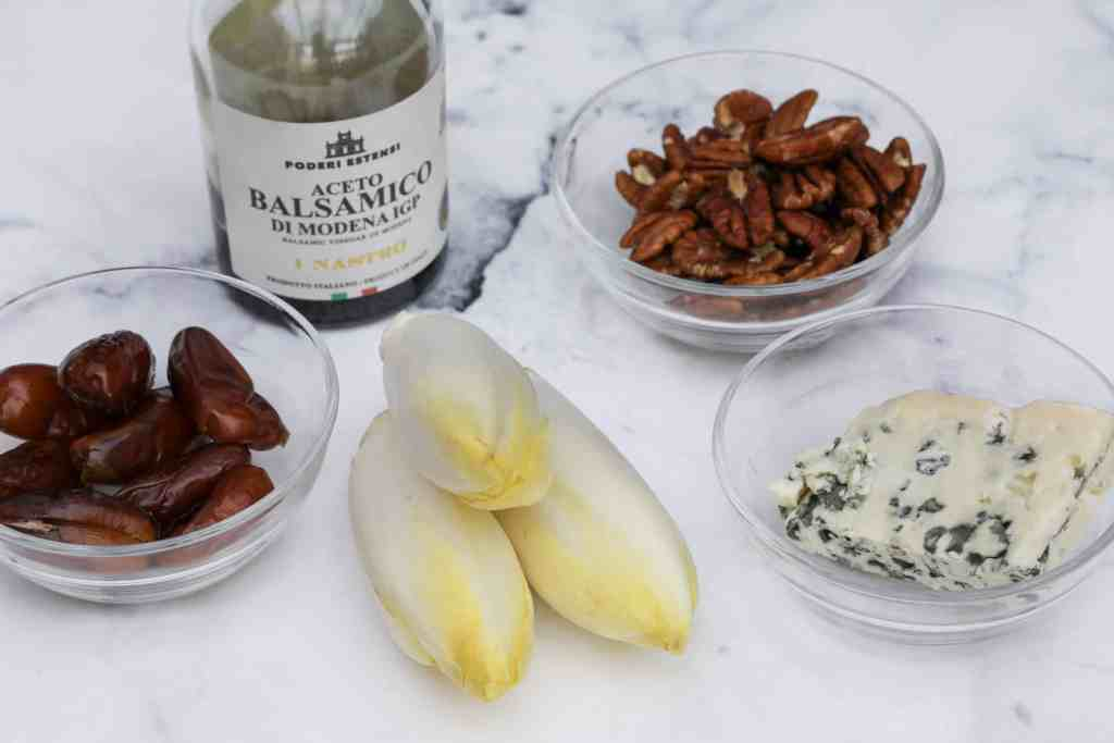 Ingredients for endive appetizer: endive, dates, walnuts, blue cheese, balsamic vinegar