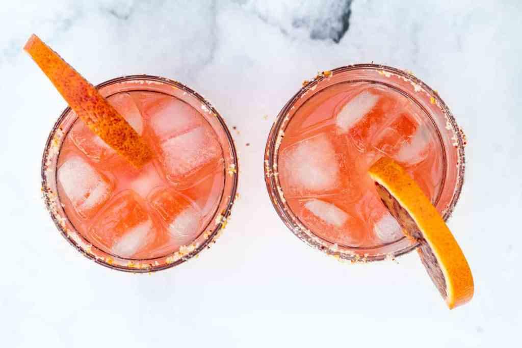 two glasses of blood orange margaritas