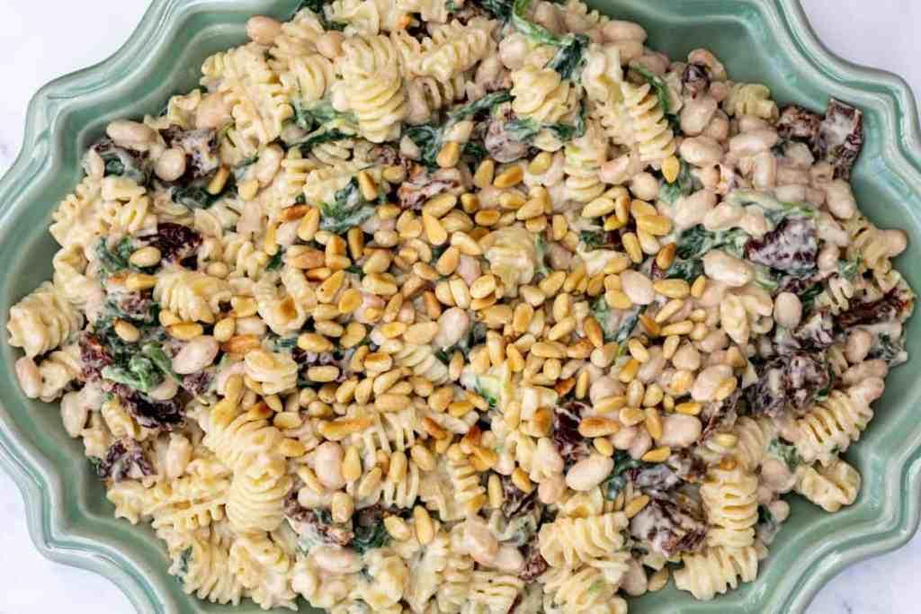 creamy artichoke pasta in serving dish