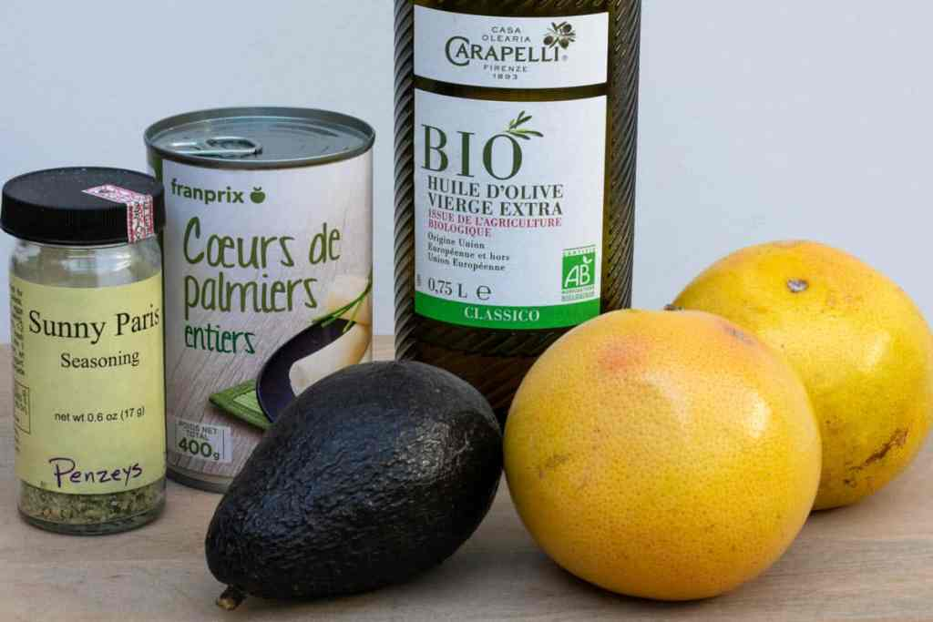 avocado, grapefruits, sunny Paris seasoning, can of hearts of palm, olive oil