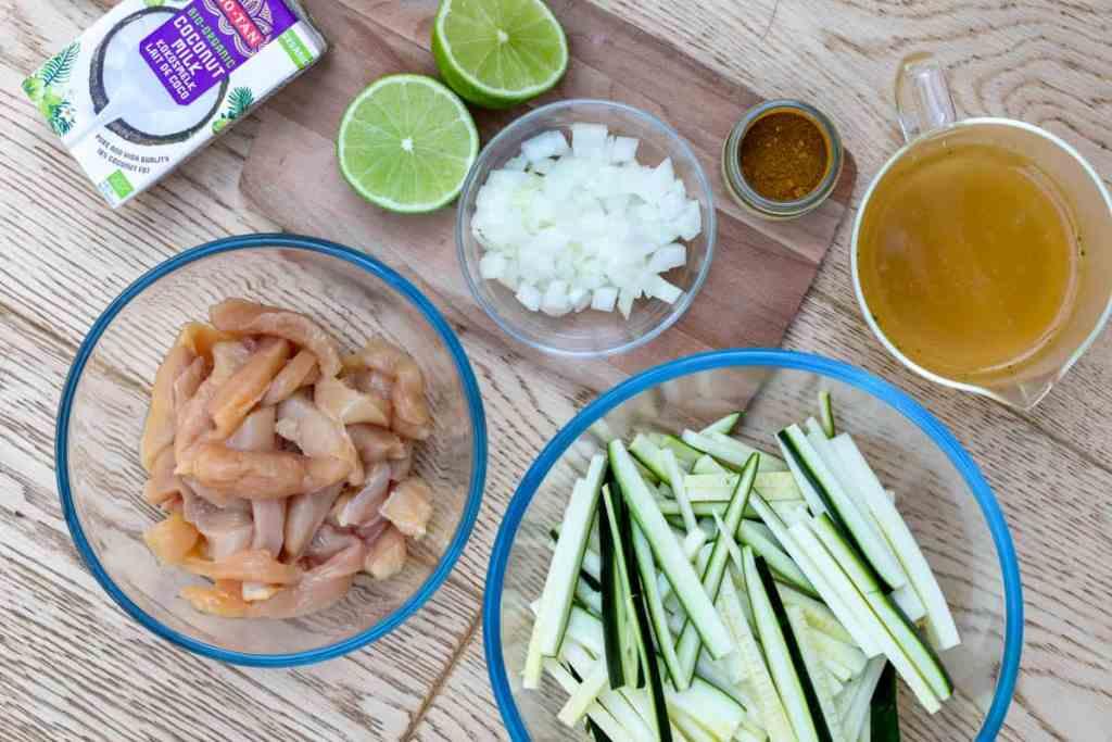 ingredients for chicken curry: chicken, zucchini, chicken broth, coconut milk, onion, lime, curry powder