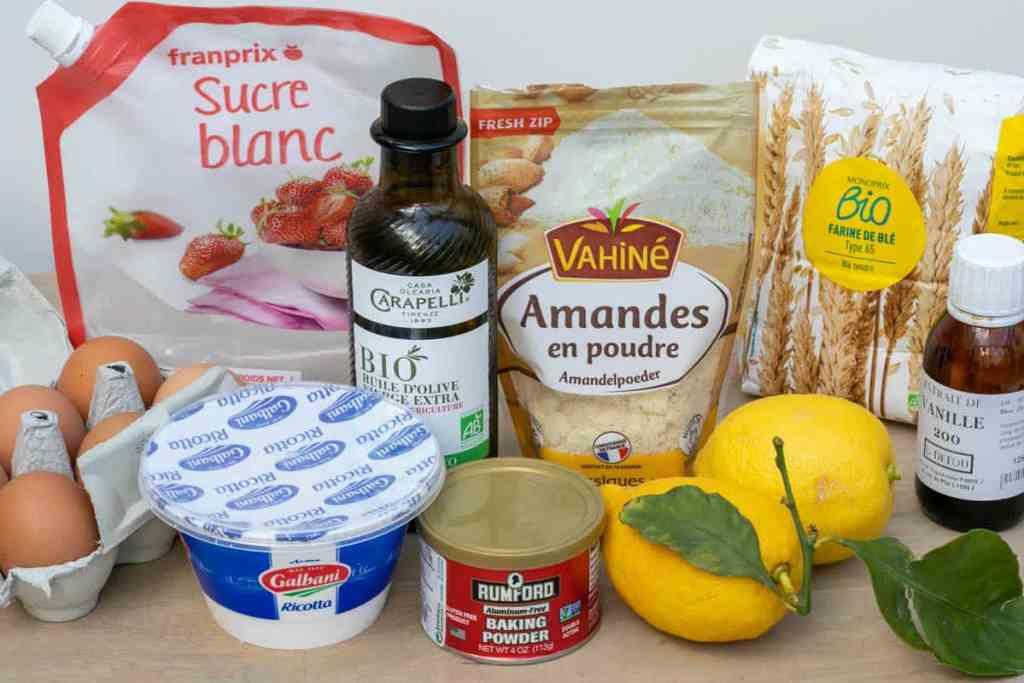 ingredient photos: eggs, sugar, ricotta, olive oil, almond flour, baking powder, lemons, flour, vanilla