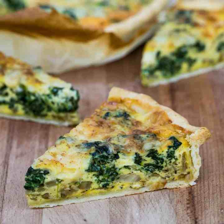 close up of piece of quiche Florentine with other pieces in background