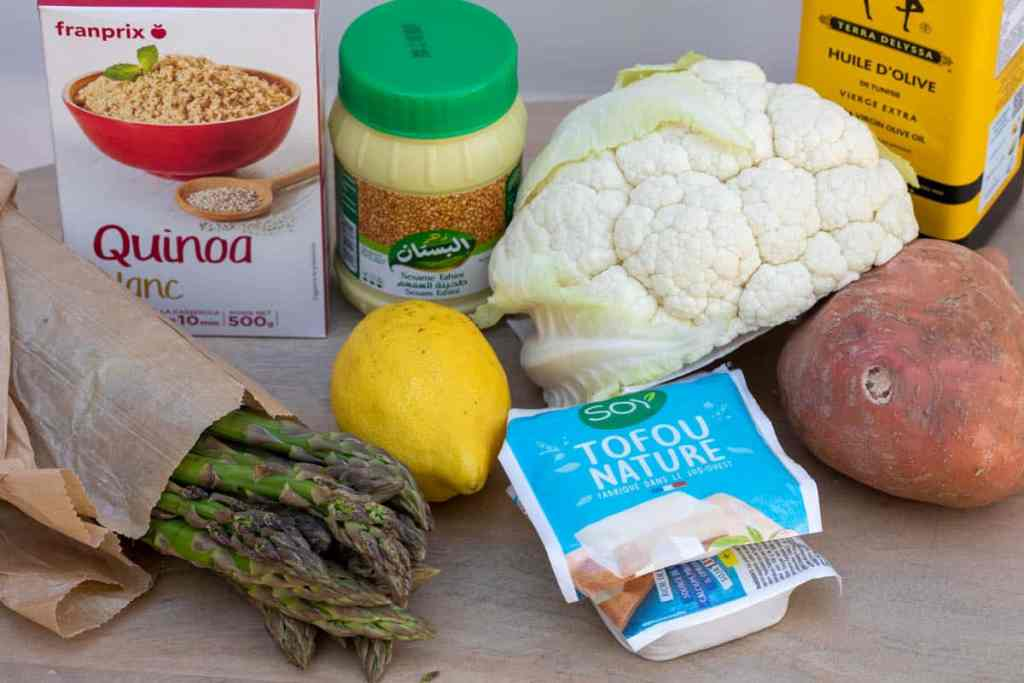 quinoa, asparagus, lemon tahini paste, tofu, half a cauliflower, sweet potato, and olive oil