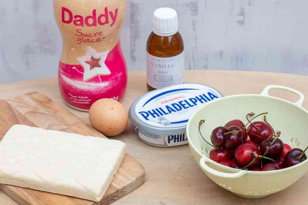 puff pastry, powdered sugar, egg, vanilla, cream cheese, and cherries