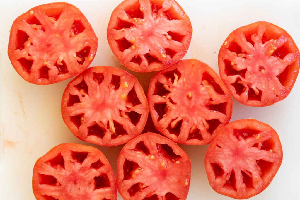 tomatoes sliced in half and seeded