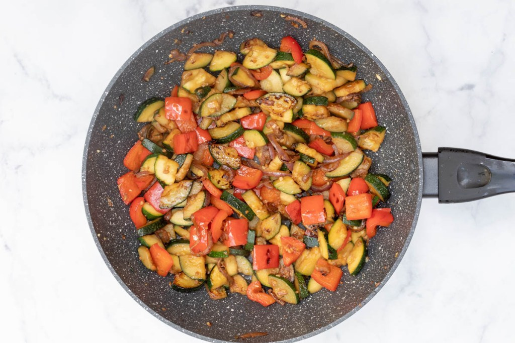 sautéed red onion, garlic, ginger, red bell pepper, and zucchini in large nonstick skillet