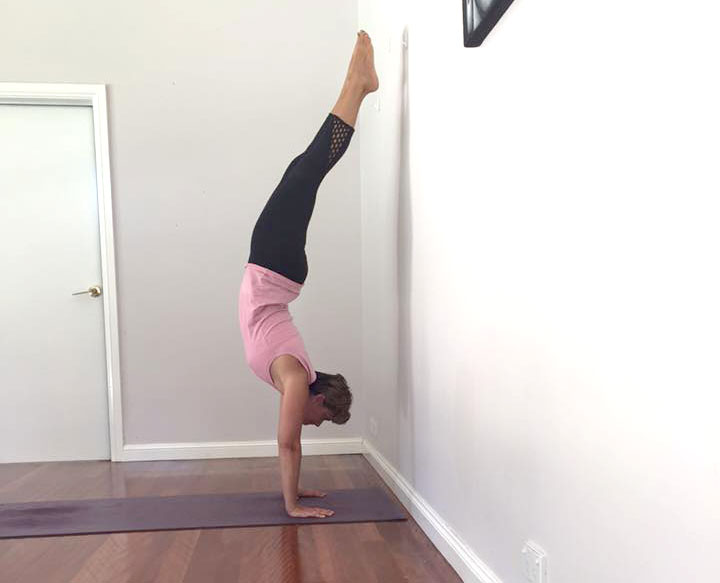 Setting fear aside and conquering a handstand.