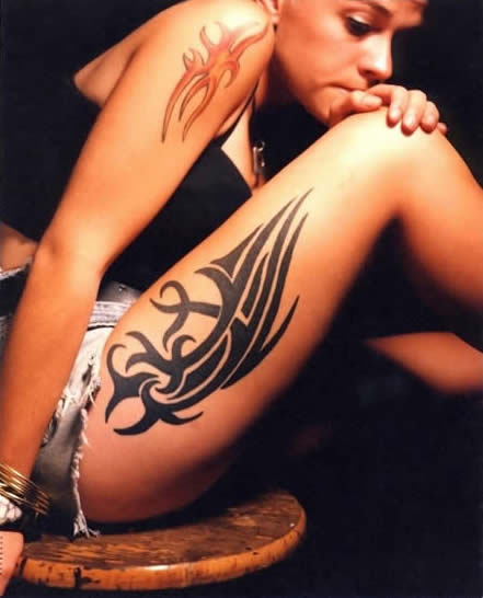 tribal thigh tattoo woman