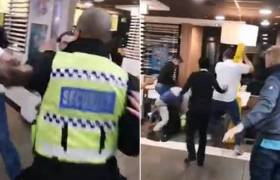 3 Men & 1 Security Guard Throw Down In McDonald's