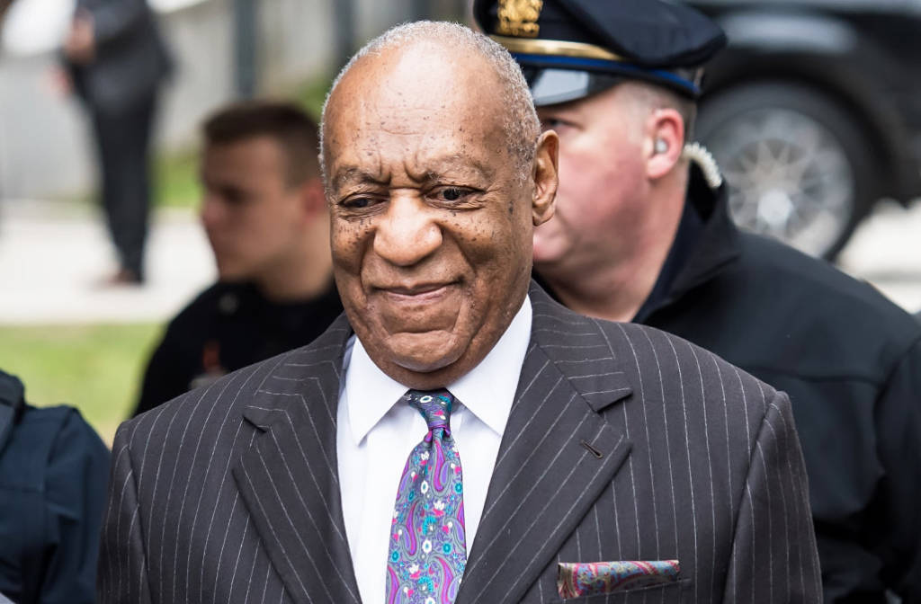 Topless Protester Confronts Bill Cosby Outside Courthouse