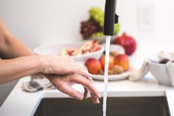washing hands in a kitchen sink