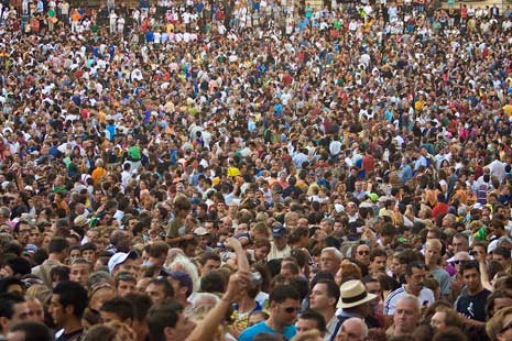 A crowd of people at Piazza del Campo