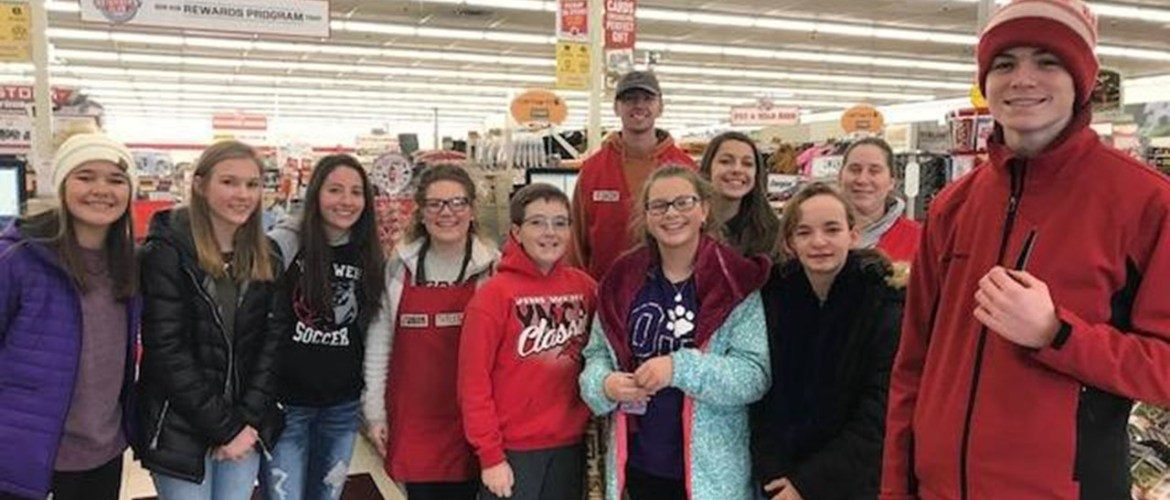 youth at grocery doing acts of kindness