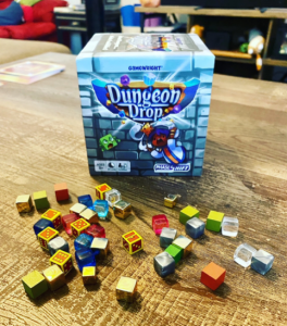 Dungeon Drop Box Art with Cubes scattered in front