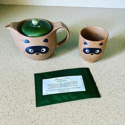 tea pot, mug and package of tea