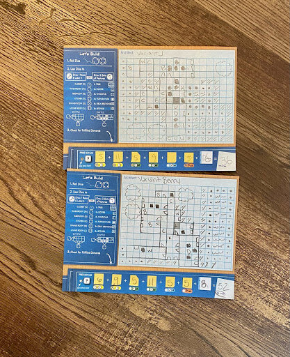 two blue prints of houses put together by J and Berry