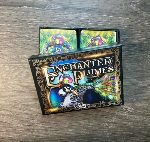 Enchanted Plumes Box, featuring a large peacock