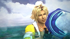 Lightskinned man with blonde hair in a yellow jacket holding a blue ball