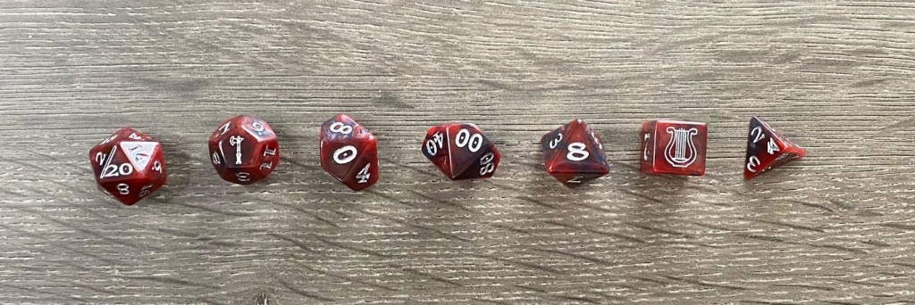 a set of polyhedral dice laid out from largest to smallest