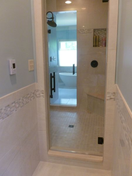 THIS LARGE SHOWER HAS 2 SHOWER DOORS, ONE EACH FOR HIS / HER BATHROOM.  DOORS FEATURE A STYLISH LADDER HANDLE IN OIL RUBBED BRONZE FINISH. PROJECTS WAS IN THE TARRINGTON SUBDIVISIION / MIDLOTHIAN, VA