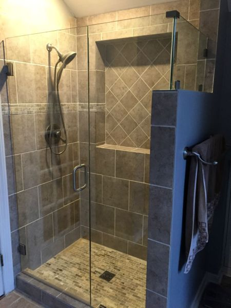 FRAMELESS CORNER SHOWER ENCLOSURE WITH BRUSHED NICKEL FINISH.  PROJECT WAS IN THE GATES BLUFF SUBDIVISION IN RICHMOND VA