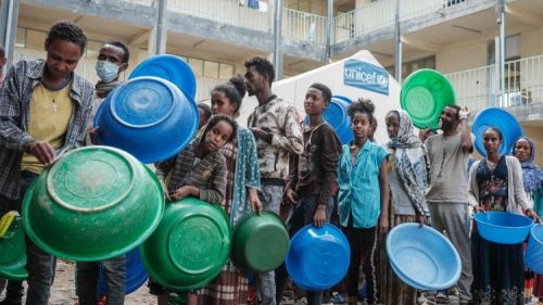 People displaced by violence in Tigray wait to receive humanitarian aid