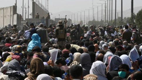 Crowds of Afghans hoping to flee the country gather near Kabul's airport