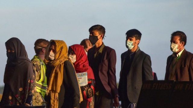 A group of Afghan citizens being evacuated from the country
