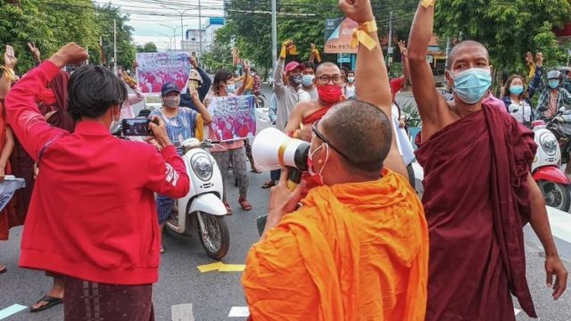 Pro-democracy demonstrators protest against the junta in Mandalay , Myanmar.