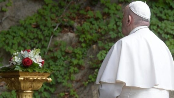 Pope Francis recites the Rosary on 30 May 2020 in the Vatican's Lourdes Grotto