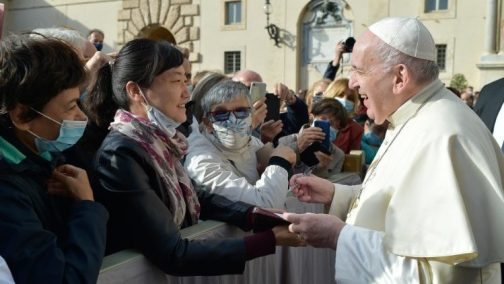 Pope Francis greets the faithful during his weekly General Audience