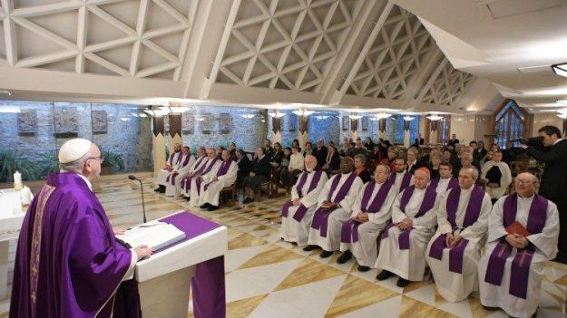 Pope Francis preaches the homily at the daily Mass at the Casa Santa Marta