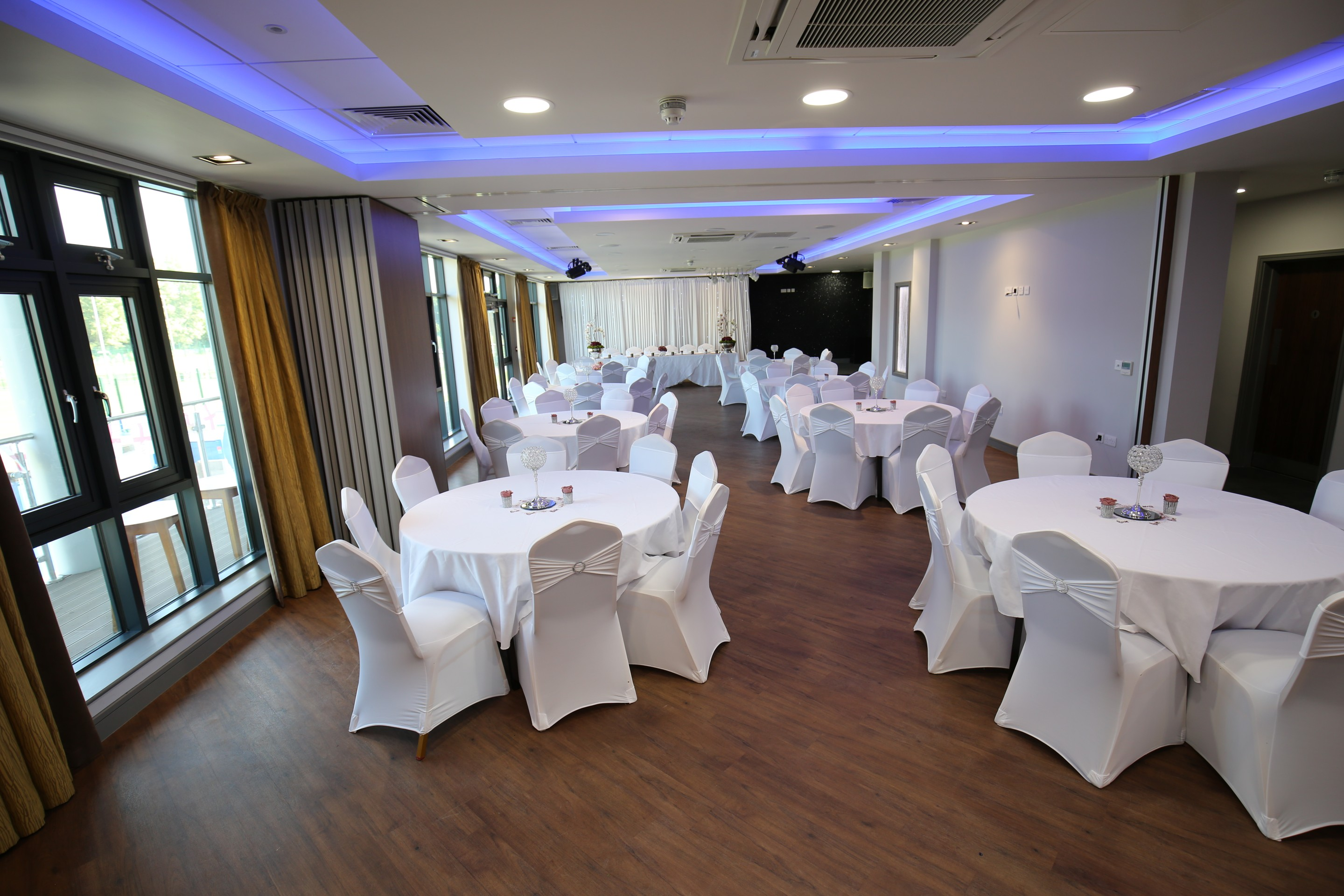 chair cover hire ellesmere port that converts to a twin bed function room wirral vauxhall motors sports club tables and chairs setup ready for wedding