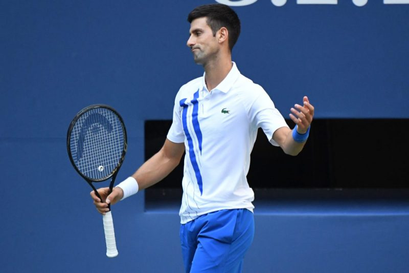 Novak Djokovic of Serbia reacts after losing a point against Pablo Carreno Busta of Spain (not pictured) on day seven of the 2020 U.S. Open tennis tournament at USTA Billie Jean King National Tennis Center. Mandatory Credit: Danielle Parhizkaran-USA TODAY Sports