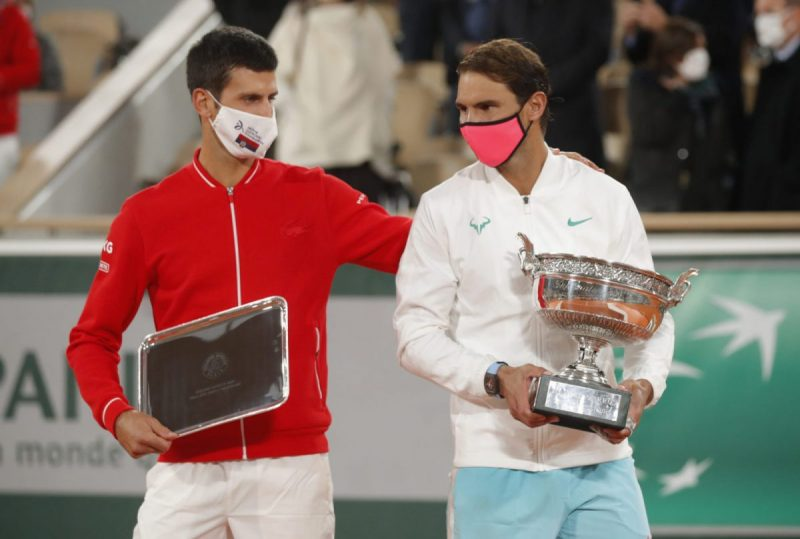 Runner up Novak Djokovic of Serbia alongside French Open winner Rafael Nadal of Spain as they are presented with their trophies after the final